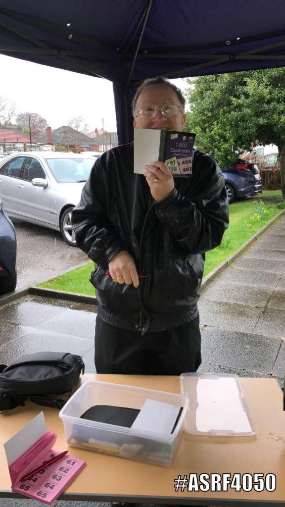 Raffle ticking selling in the rain!
